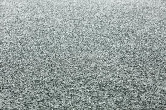Regentropfen auf dem See