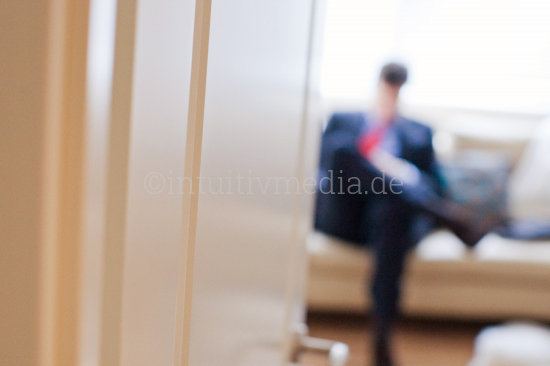 businessmen sitting in a room and waiting