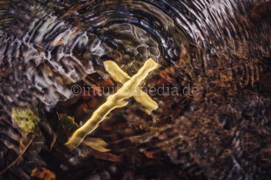 Golden cross under water