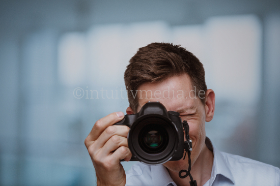Photographer behind dslr camera