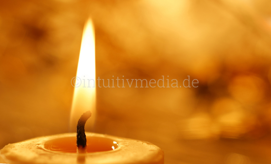 Flame of a candle closeup