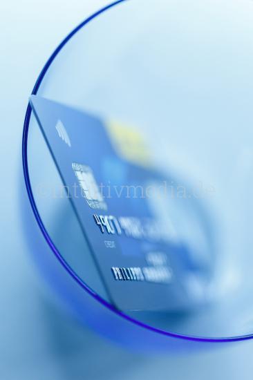 Credit card in glass closeup