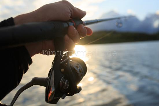 Angler hand holding fishing rod
