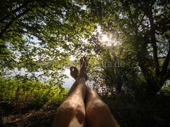 Legs and feet pointing to sunlight