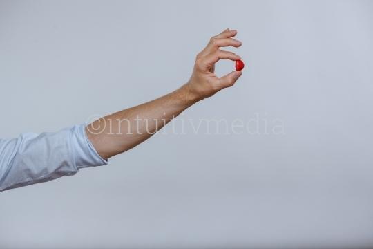 Rotes Bobon in der Hand